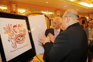 Mark Bonchol, Secretary of YPS Board of Trustees, explained the logo design to the Chief Minister